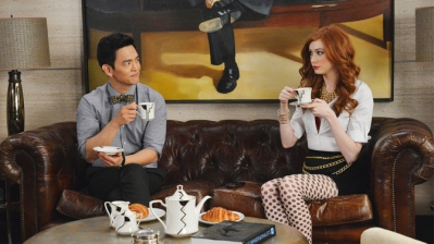 John Cho as Henry Higgs and Karen Gillan as Eliza Dooley
